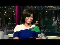 Mrs. O looks lovely wearing a colorblock Preen Pre-Fall 2012 dress and Alexis Bittar marquis pin.