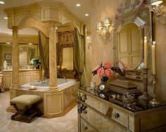 I love marble bathrooms, particularly ones with the warm gold tone. Very luxurious. Hope there's a nice window view!