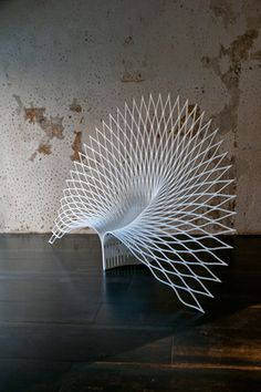 "Peacock Chair @ SALONE 2014 ""Peacock"" is made from a type of acrylic composite that has the ability to transform, but requires a delicate process involving manipulating a single sheet within minutes. Designer UUfie"