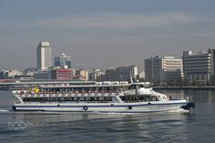 passenger ferry - passenger ferry travelling across izmir bay on a clear,,sunny and calm autumn day.marine transportation plays an important role in the transport network of the city.