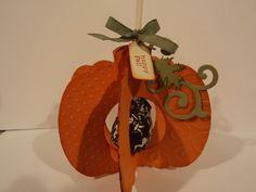 Pumpkin Pops -- made using Spellbinders Pumpkin Dies. Used the largest die and cut out 6 pumpkins, embossed them, and then stacked them to make the holder. More deets and additional photos on my blog. TFL and YOLO.   My blog is: cardcornerbycandee.blogspot.com