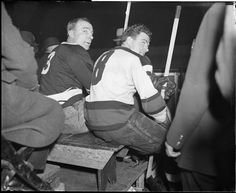 Hockey stars Lionel Conacher, left, and Roger Jenkins of the Bruins, on bench for being rough on the ice