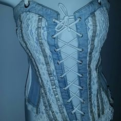 Unique Brazilian corset style top fits S/M adj. Final Price↘️ Brazilian denim, laces, adjustable frontal lace top fits S-M Used several times.. Price reflects used condition  It has been stored for a while  Its Gorgeous!!! Very Unique! Tops