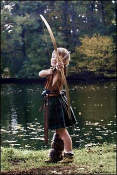 Little Archer in a kilt...