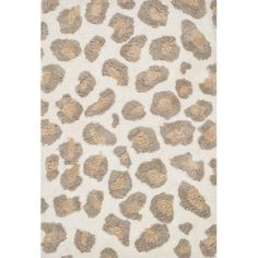 Showcasing a shag design and an animal-print motif, this hand-tufted rug brings an exotic pop of pattern to your living room or den seating group.
