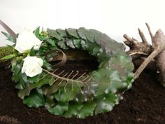 Academy of Floral Art Floristry School Stunning basing using Galax leaves, level 3 funeral. Victoria Lawrence Turner.