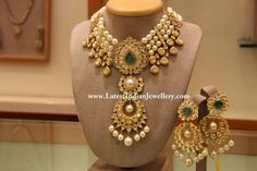 22 carat gold choker strung with south sea pearls and a central two step pendant studded with kundans, emerald and south sea pearl drops, paired up with matching earrings. Indian Jewellery Design, Latest Jewellery, Jewelry Design, Pearl Jewelry, Wedding Jewelry, Gold Jewelry, Dior Jewelry, Pearl Necklaces, Sapphire Jewelry