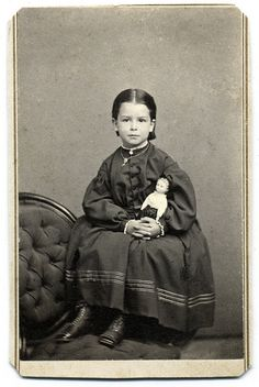 A Girl and Her Best Friend, 1865 on Flickr. Carte de visite by Bowers of Lynn, Mass with tax stamp reading October 9th.