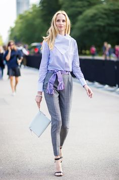 Lauren Santo Domingo dresses up a conservative work outfit with tasseled accessories. // street style