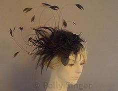 Nom De Plume, a black feathery fascinator by Polly Singer.