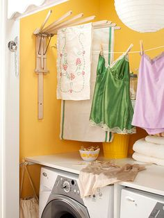 *Keep a Clothes Line Handy* Save on electricity by letting delicates air-dry. An old-fashioned wooden drying rack fans out to let air circulate around items. Install a retractable clothesline on opposite walls or door facings. Laundry Nook, Laundry Closet, Laundry Room Organization, Laundry Room Design, Wooden Drying Rack, Wood Rack, What A Nice Day, Design Basics, Clothes Drying Racks