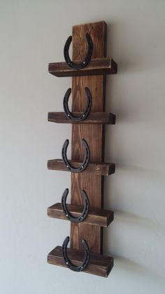 Rustic Horseshoe Wine Rack by Route66Rustics on Etsy https://www.etsy.com/listing/214872524/rustic-horseshoe-wine-rack