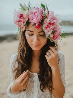 Peony floral crown for this surprise engagement photoshoot. Sporting a shimmering Heidi Gibson engagement ring, her hair is loose beachy mermaid waves, and a flowy bohemian dress.