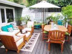 Turquoise accents on a neutral but pretty deck (more photos at the linked blog post).