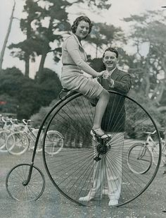She is my hero. Riding a penny farthing in a skirt and heels!   circa 1930