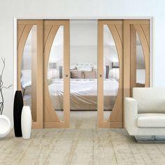 Quad Telescopic Pocket Salerno Oak Veneer Door - Clear Glass.    # glazeddoors #designerdoors #oakdoors   #pocketdoors #internaldoors #telescopicdoors #hiddendoors #disappearingdoors #moderndoors