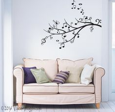 Decorate your living space with this music tree, music note wall decal. +++++The photo listed above shows this bedroom wall decal in its largest measurements. Please note that the size of the wall decal in the picture has been enlarged to show detail. Please review the sizes offered to fit your space.+++++ Vinyl decals can be applied to any clean, smooth and flat surface. You can put them on your walls, doors, windows or anywhere you want! Vinyl decals are faster, cleaner and easier than…
