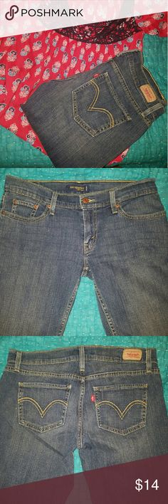 Levis Too Superlow 524 Skinny Jeans Medium blue pair of Levis Too SuperLow skinny  style 524. Based on the measurements I believe they are a size 12. However please check measurements before purchasing.  Waist 17 inches flat Hips 19 inches flat Rise 8 inches Inseam 28.5 inches Leg opening 6 inches Levi's Jeans Skinny