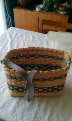 Book Basket with cloth handle. Also based on the same basic berry basket weave. Again used colors. Another tip from my basket making teacher, work at the community pool. Underwater basket weaving is no joke, you really need to keep the basket wet all the time so either you have a spray bottle going constantly or sit in the pool. :)