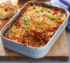 Melanzane parmigiana - Meaning 'aubergine Parmesan' in Italian, this vegetarian bake with tomato and cheese is ideal for entertaining.
