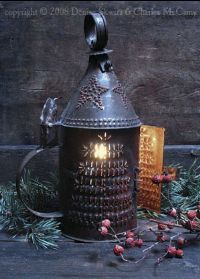 I have a lantern just like this that was custom made for me by a tin smith friend. The way it sends light patterns is awesome. (Mine is wired for electricity if I choose, or candles if I don't. Primitive Lighting, Antique Lighting, Rustic Lighting, Primitive Decor, Christmas Candle, Christmas Tree, Flameless Candles With Timer, Old Lanterns, Devine Design