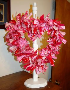 Pinterest inspired Valentine Wreath made with just ribbon and wire coat hanger!