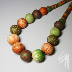 Polymer clay jewellery by E.H.design, via Flickr