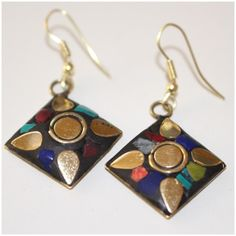 Earrings w/ Brass, Turquoise, & Coral Inlay India Earrings w/ Brass, Turquoise, & Coral Inlay --- Handmade in India --- Diamonds have 1.5 cm sides --- Offers not accepted on retail items ---  thank you for visiting my closet Boutique Jewelry Earrings