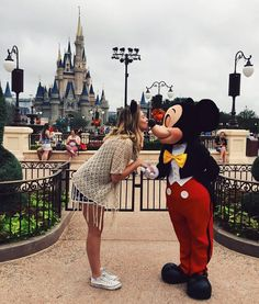 I would love love love love to take a picture with both Mickey and Minnie mouse. My man can take as many pics with all the princesses as long as I can take one with Mickey.