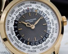 Patek Philippe World Time 5230R-001, 5230R, 5230R001, NEW MODEL released at Basel 2016, 18k rose gold case with a rose gold deployment buckle, automatic Patek Philipe 240HU movement, 48 hour power reserve, charcoal gray hand guilloche dial, white outer ring displaying all the cities and time zones around the world, rose gold dagger style hands, sapphire crystal, display back, size 38.5mm, Unworn with original box and certificate dated Jan / 2017.