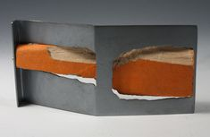 teresa F. Faris. Brooch: Collaboration with a Bird, 2009. Sterling silver, Wood Chewed by a Bird. 5.1 x 12.8 x 2.6 cm.