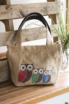 Three little owls go out on a limb for fair trade -- and it's a hoot! Our tote bag dresses up a fine feathered trio in delectable colors and precious expressions.