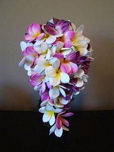 A beautiful frangipani teardrop bouquet perfect for a beach wedding!