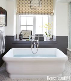 The Michelangelo soaking tub from Hydro Systems takes center stage in the master bath. Ballard Designs lantern.
