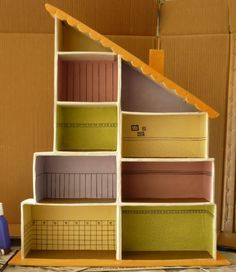 Cardboard doll house, can use sturdy diaper boxes.