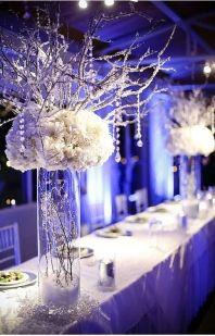 Pretty winter wedding head table flowers