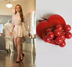 """Cheryl Blossom (Madelaine Petsch) wears this red heart pin with cherries in this episode of Riverdale, """"Chapter Fourteen: A Kiss Before Dying"""". It is the Bakelite Heart Pin with Cherries."""