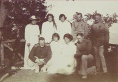 Back row-Ania Vyrubova, Grand Duchesses Marie, Tatiana. Tsar Nicholas II, Officer, Front row Officer, Grand Duchesses Anastasia, Olga and Officer
