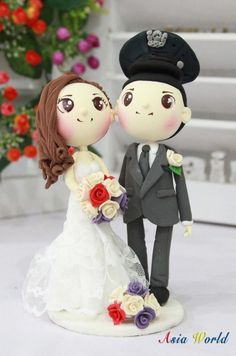 Wedding Cake topper, NYPD and his beautiful bride in lace strapless mermaid wedding dress clay doll, clay miniature, clay figurine by AsiaWorld on Etsy https://www.etsy.com/listing/153897731/wedding-cake-topper-nypd-and-his
