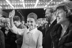 """The actress Audrey Hepburn photographed with her husband by Fred Ward during their arrival at the Warner Theatre, in Washington, D.C. (USA), for the premiere of her new movie """"My Fair Lady"""", on October 20, 1964."""