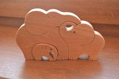 Items similar to Wooden elephants family - Mother's Day gift - Puzzle toy - Animal puzzle - Educational toy - Kids gifts - Natural eco friendly - Waldorf on Etsy Pet Toys, Baby Toys, Children's Toys, Kids Toys, Wood Log Crafts, Tier Puzzle, Elephant Nursery Decor, Wooden Elephant, Animal Puzzle