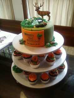 Hunting Theme Birthday cake! I like the idea of having a cake on top and cupcake on bottom!