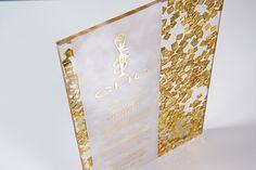 A custom acrylic invitation with suspended confetti for the 2014 CLIO Awards.