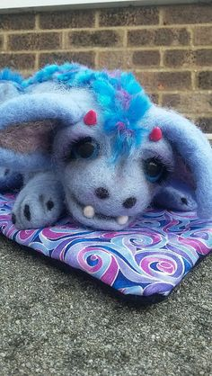 Hey, I found this really awesome Etsy listing at https://www.etsy.com/uk/listing/267469207/baby-dragon-with-handmade-blanket-and