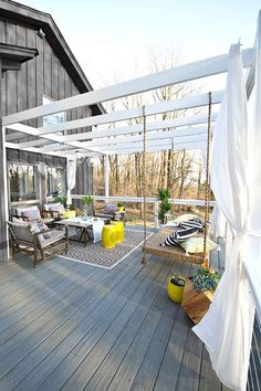 This deck makeover includes so many great outdoor decorating ideas, from a hang bench to modern cable railing. It's hard to choose our favorite. Great design work by Sarah Dorsey of Sarah M. Dorsey Design. See her deck makeover on The Home Depot Blog. || /smdorsey/
