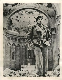 """1944- General Bernard Montgomery makes a ruined Italian church one of the first stops on his """"sight-seeing"""" tour, shortly after the British 8th Army wrested the town of Fossacesia, Italy, from the Germans."""