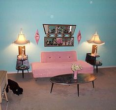 Incredible 1950's corner of a living room. Love the use of pink and teal in mid century home design. Also dansette/ atomic legs on everything please? Interior kitschy design