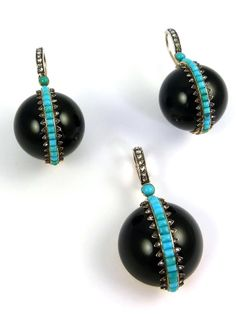 Pair of 19th century turquoise, rose cut diamond and onyx ball pendant earrings and matching dome pendant locket, French c.1860, the earrings formed by a carved onyx sphere applied down the front with a line of calibre cut turquoise bordered by rose cut diamonds in a zigzag mount, surmounted by a cabochon turquoise from an arched line of diamonds, the en suite pendant with a semi-sphere onyx, glazed locket compartment to verso, mounted in silver and gold