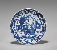 """I. M. Chait Gallery : Full Details for Lot 155. MING WANLI BLUE & WHITE PORCELAIN DISH Very finely detailed, Chinese Ming Dynasty, Wanli Mark and of the Period, blue and white porcelain dish; the circular footed form showing a figural scene of children bathing in a tub within a garden setting, flanked by four five-clawed dragons and flaming pearls; the verso with six branches of auspicious fruits including peach, pomegranate and lychee; D: 7""""; Provenance: The Wolch Collection, Los Angeles"""