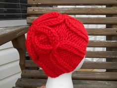 It's easier than it looks! If you can knit & purl, you can make this hat! Free pattern by Delaware Head Huggers calls for Hometown USA and size 13 knitting needles.